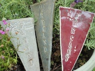 Plant Markers for the herbs and plants with a variety of colours and plant names basil, thyme and more