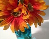 Blue Glass Vase with Orange Flowers