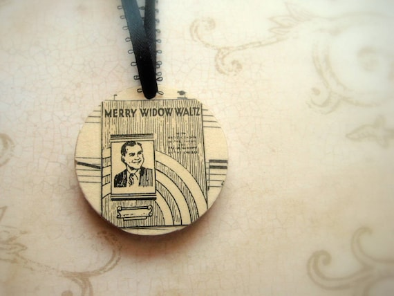 Merry Widow Waltz decoupaged wooden ornnament with vintage sheet music. One of a kind handmade Christmas ornament