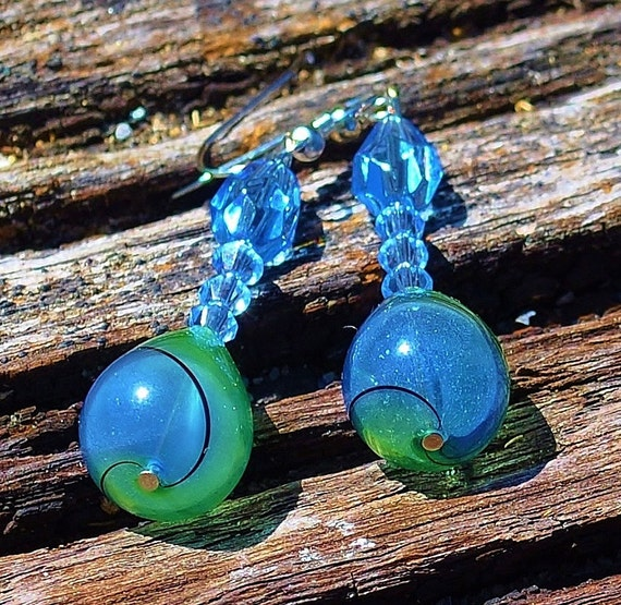 Wwirled glass dangle earrings in blue and green
