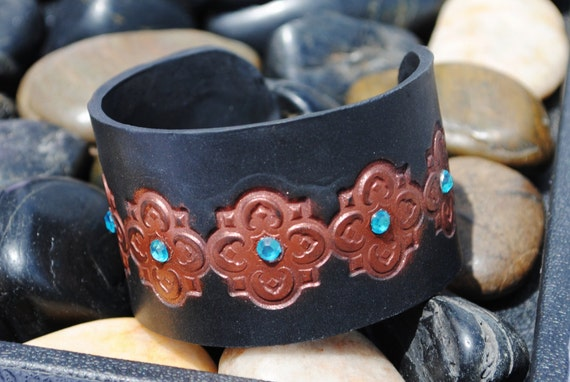 Antique Copper.  Cuff Bracelet.  Black with scroll designs.  Adorned with blue gems.