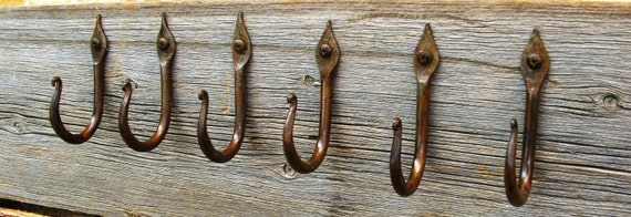Wrought iron wall hooks with candle flame ends