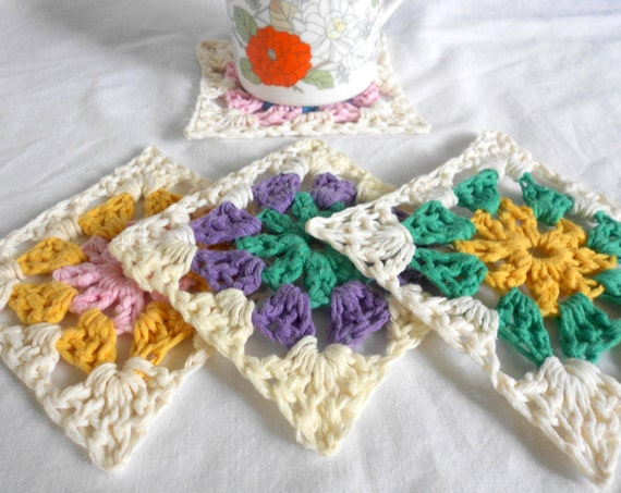 crochet coasters . multi colored. granny chic