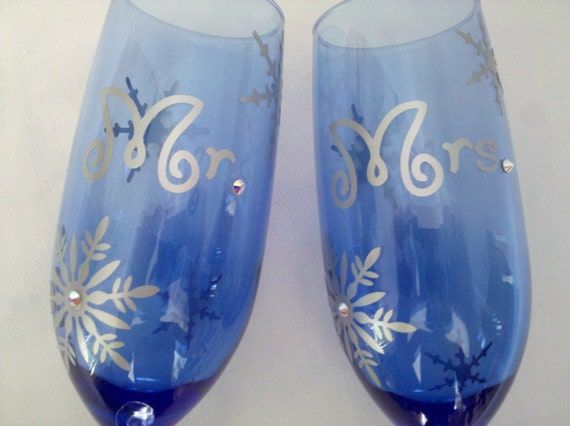 Mr. and Mrs. Christmas toasting flutes, unique champagne glasses for winter wedding.  Swarovski crystals and silver snowflakes