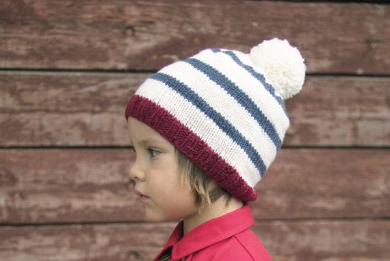 Pom pom striped knit hat for boys and girls.