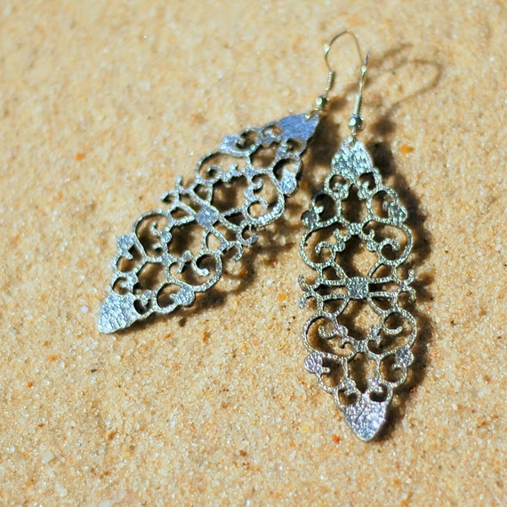 Laser cut leather earrings.