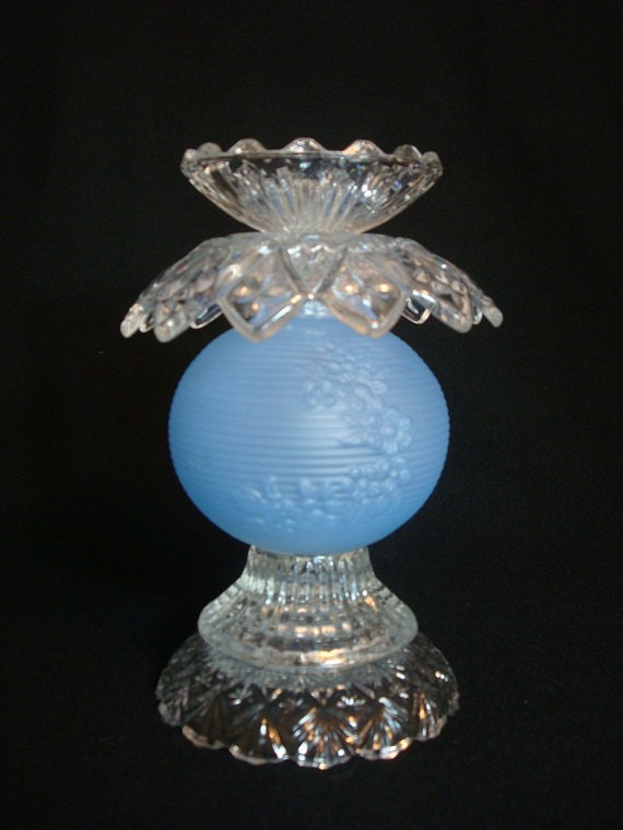 Garden art or candle holder made with re-purposed blue glass. Up-cycled art.