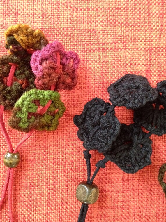 Bracelet - Wool Flowers, leather lace and wood bead.