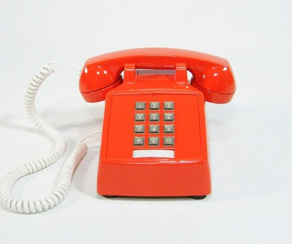 Vintage telephone tangerine orange push button phone