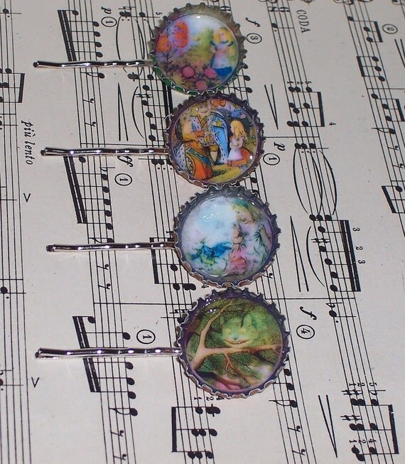 Four Alice in Wonderland-themed hair pins resting atop a sheet of music