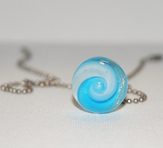 blue and white sparkly glass pendant