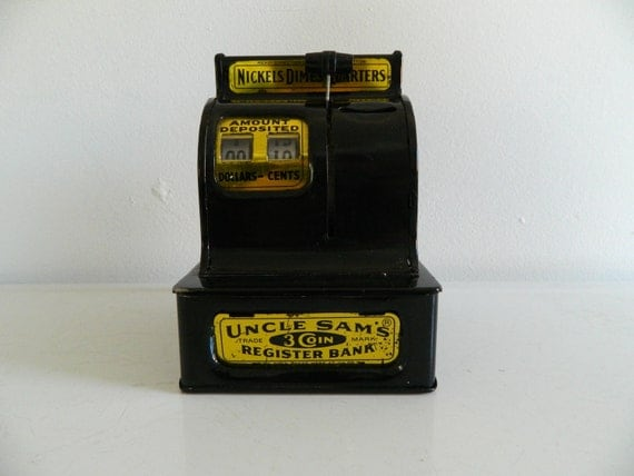 Black vintage coin bank toy