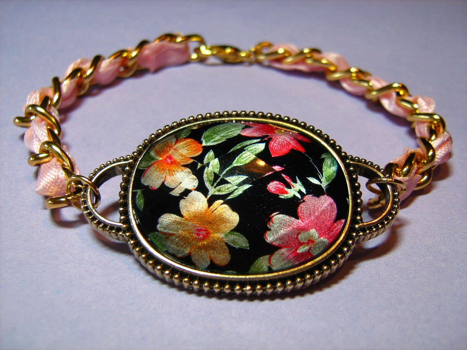 Floral Oval Pendant with a Pink Satin Ribbon and Goldtone Chain
