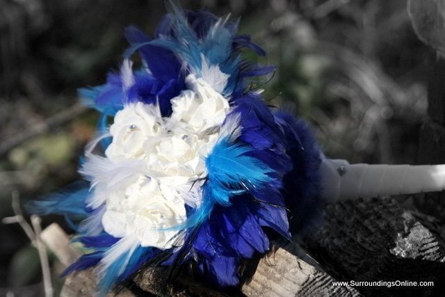 White Winter Wedding Bouquet with Royal Blue Feather Accents